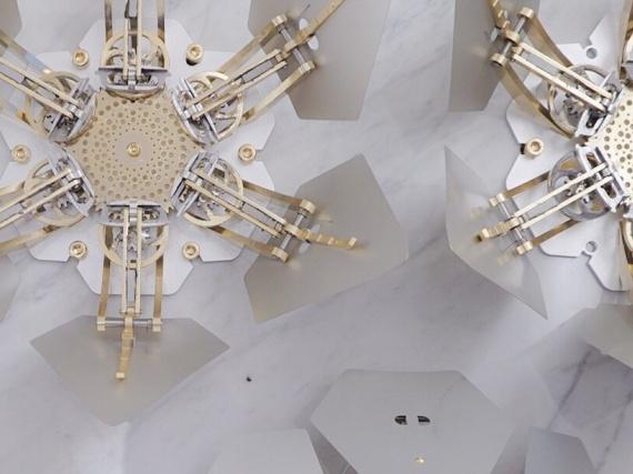 Дизайн-студия WHYIXD создала для здания в Тайване 140 механических рододендронов